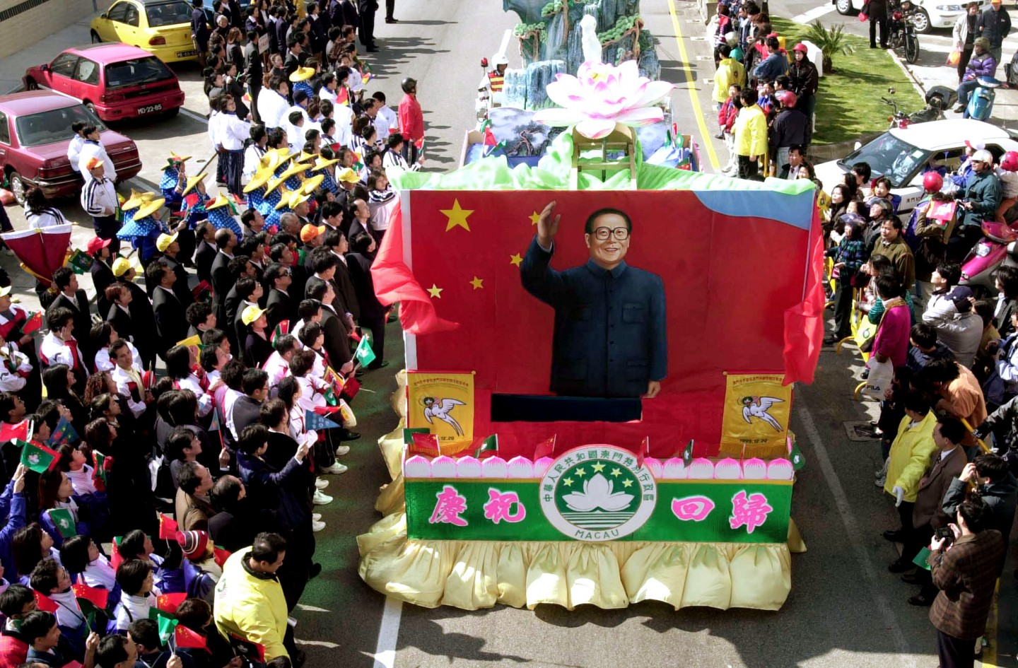 The people of Macau felt a strong sense of belonging to China and welcomed the handover. The photo shows a celebration parade of floats and dancers weaving through the streets of Macau in celebration of the return of Macau to China in 1999. (SPH)