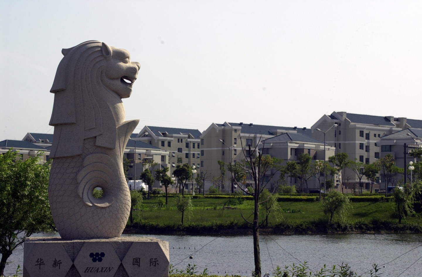 The Chinese officials' experiences help shape the Chinese public's perception of Singapore. The photo shows a mini Merlion overlooking residential blocks in Suzhou. (SPH)