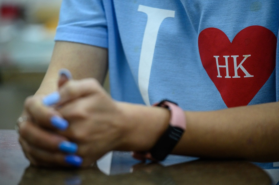 Wearing their hearts on their sleeves ( Philip Fong / AFP)