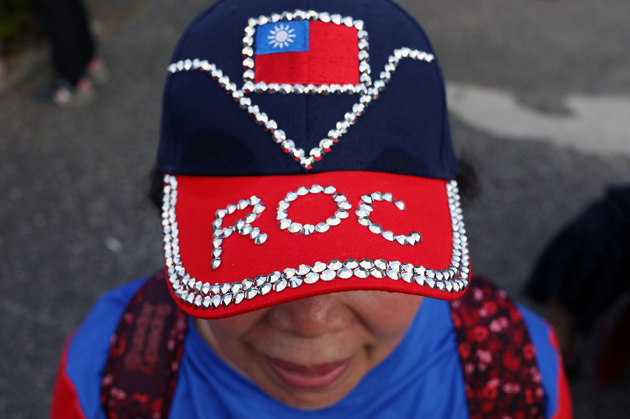 A supporter wearing a hat with a Taiwanese flag attends a campaign rally for Taiwan's KMT presidential candidate Han Kuo-yu, in Kaohsiung, Taiwan, on 21 December 21 2019. (Ann Wang/Reuters)