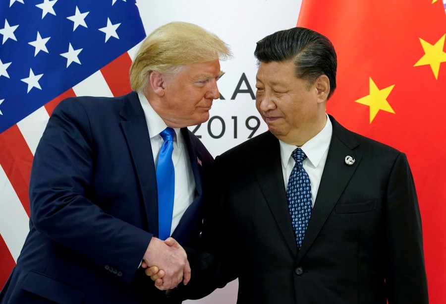 "China and the US have reached a ""phase one"" trade deal. Will it be enough to end the trade war? (Kevin Lamarque/REUTERS)"