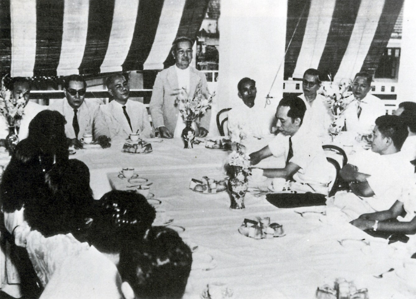 Mr Tan Kah Kee (standing) addressing a gathering of Chinese community leaders in the Ee Hoe Hean Club during the 1930s. (Ee Hoe Hean Club)