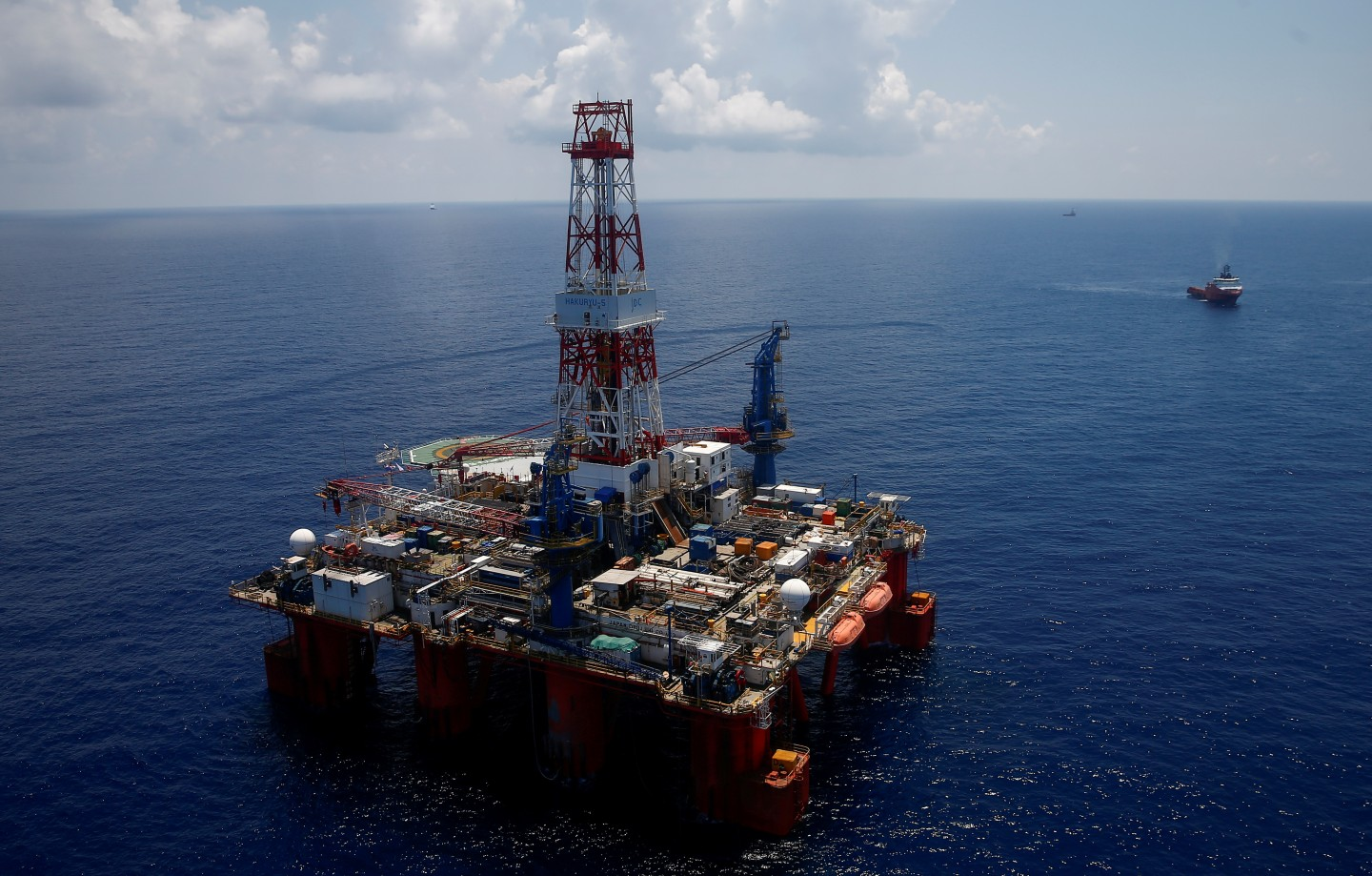 There is a longstanding dispute between the two over maritime rights and territorial claims in the South China Sea which has undermined mutual trust. A general view shows JDC Hakuryu-5 drilling rig and supply vessels in the South China Sea off the coast of Vung Tau, Vietnam April 29, 2018. REUTERS/Maxim Shemetov/File Photo
