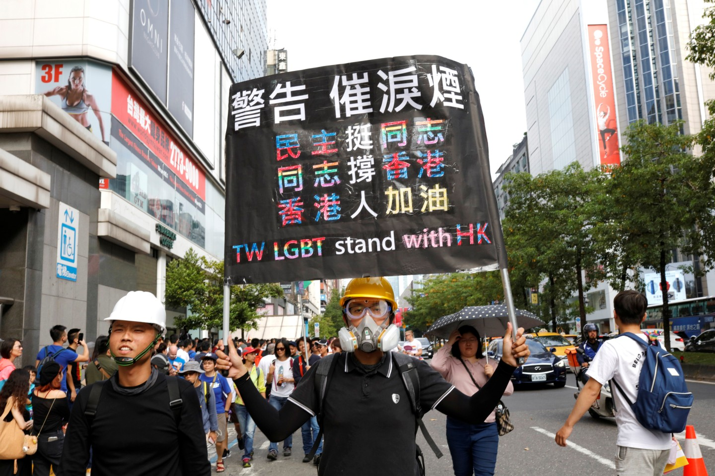 A participant holds a placard showing support for pro-democracy protests in Hong Kong, during the LGBT Pride parade in Taipei, Taiwan October 26, 2019. REUTERS/Eason Lam