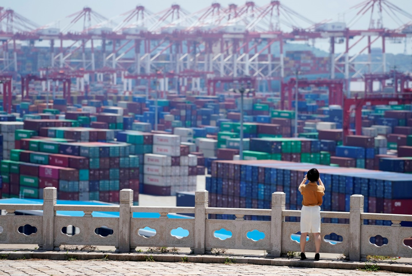 China has developed in a globalised world and reaped huge benefits in the process, driven by the country's economic reforms and its people's efforts. The picture shows containers at the Yangshan Deep Water Port in Shanghai, China, August 6, 2019. (Aly Song/File Photo/Reuters)