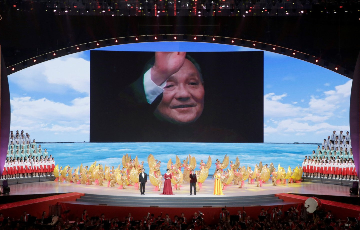 A picture of late Chinese leader Deng Xiaoping is seen on a giant screen during a cultural performance in Macau, China December 19, 2019, on the eve of the 20th anniversary of the former Portuguese colony's return to China. (Jason Lee/Reuters)