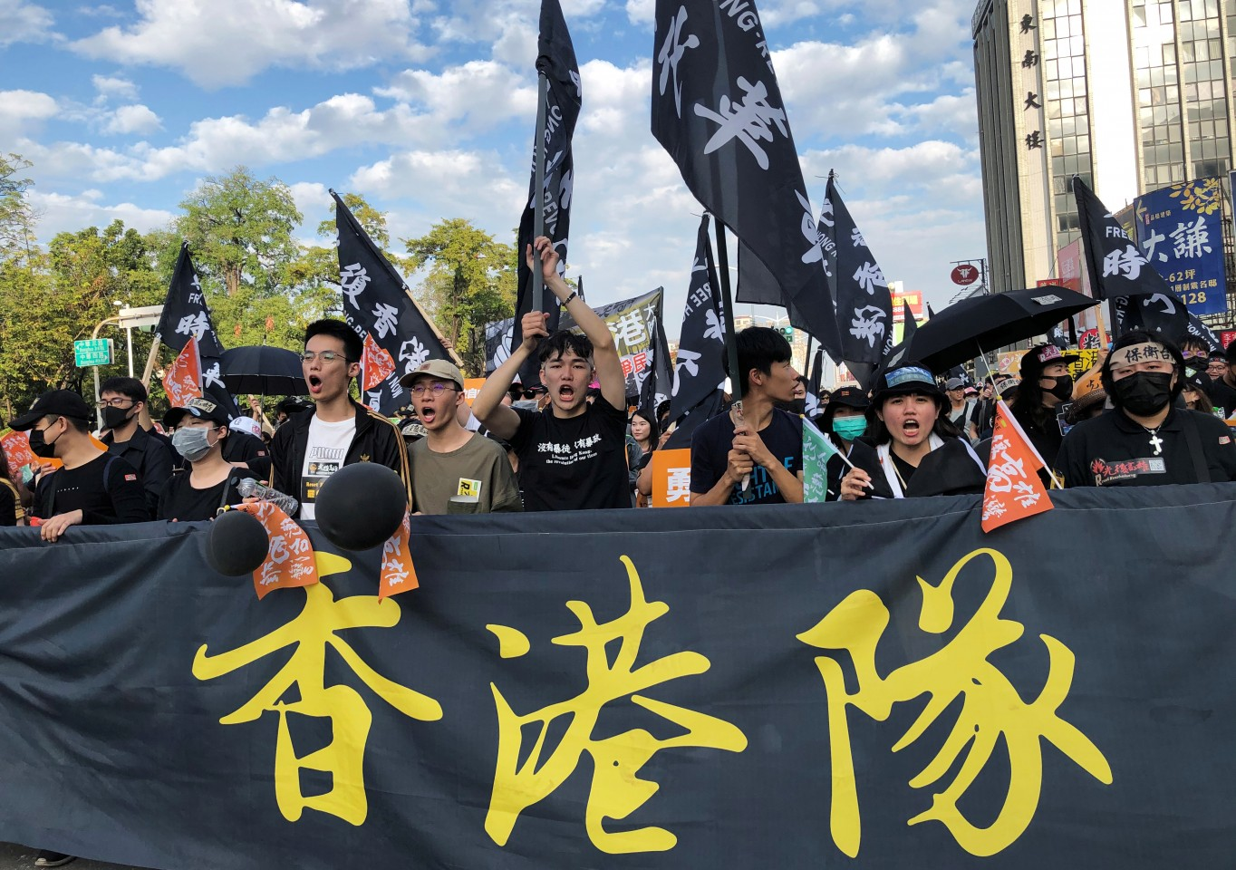 Protesters hold banners and flags in support of Hong Kong's pro-democracy protests, during a rally against main opposition Kuomintang party's presidential candidate Han Kuo-yu, in Kaohsiung, Taiwan on December 21, 2019. (Yimou Lee/Reuters)