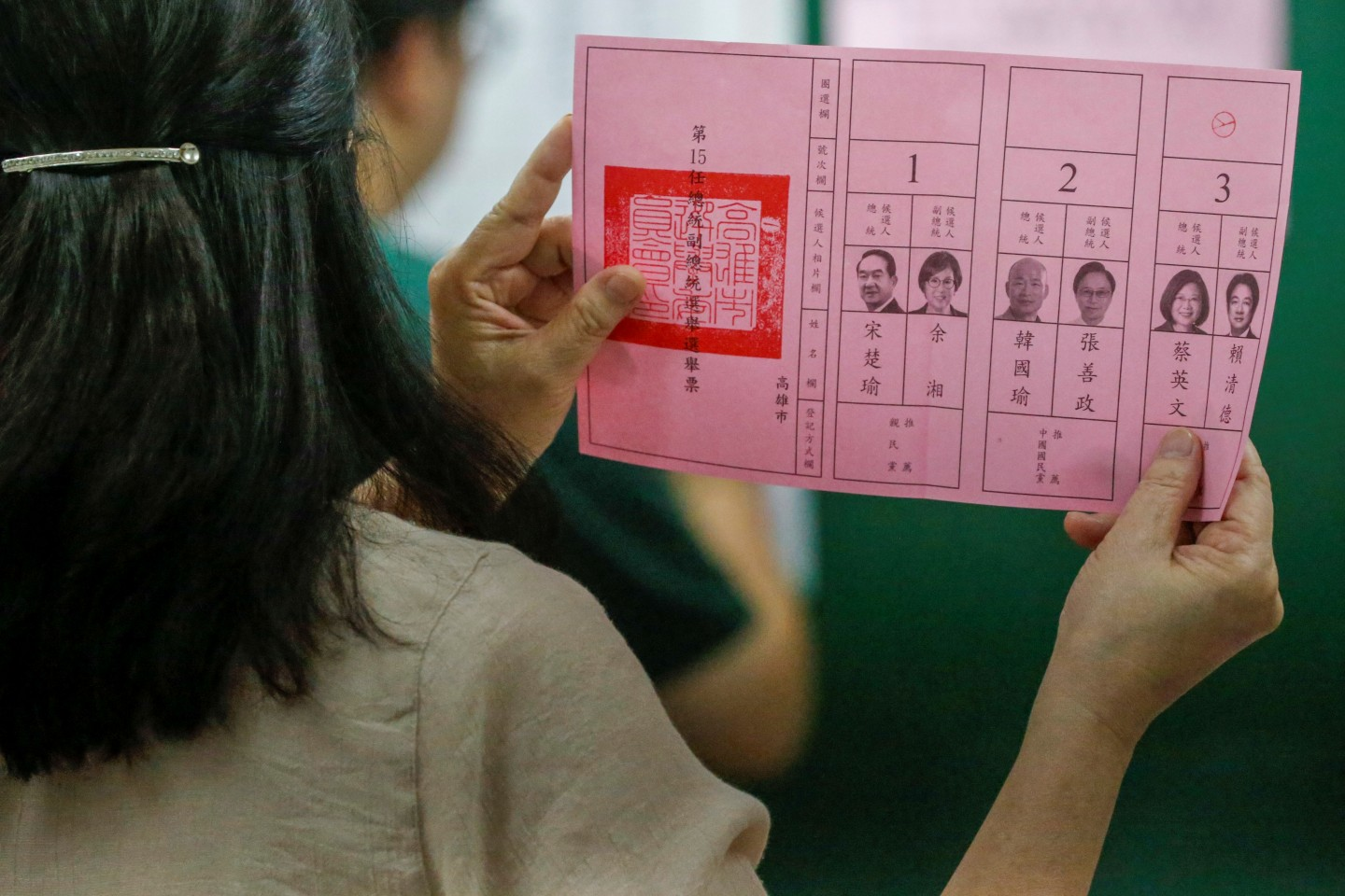"Various state media have accused Tsai of resorting to ""dirty tactics"" to get votes. In the picture, an election official shows a ballot with vote for Taiwan President Tsai Ing-wen as votes are counted at a polling station in Kaohsiung on 11 January 2020. (Ann Wang/Reuters)"