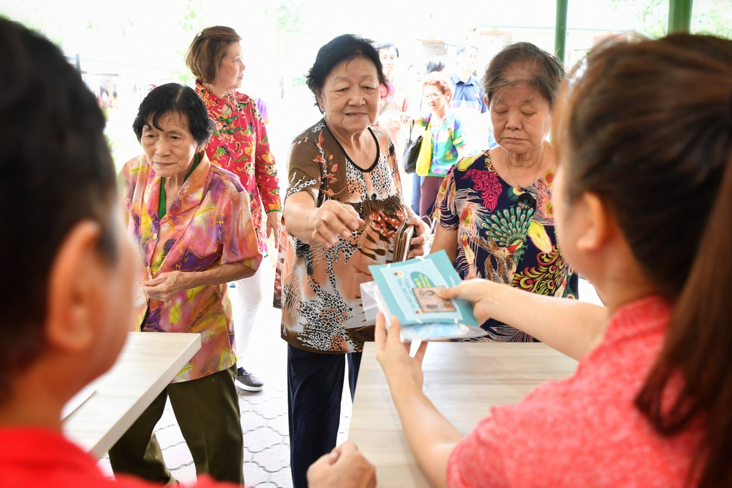Each household will be receive a pack of 4 masks from the government. Residents are seen collecting their masks at the Kampong Glam Beach Road Residents' Committee centre, on 1 February 2020. (SPH)