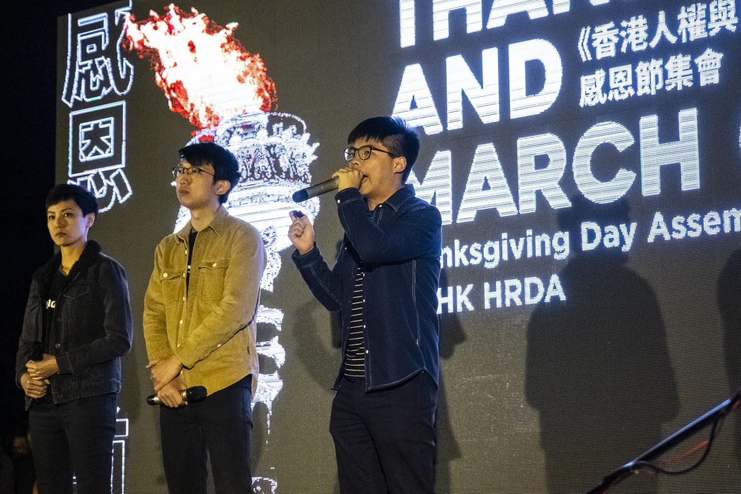 """Joshua Wong, co-founder of the Demosisto political party, delivers a speech during the """"Thanksgiving Day Assembly for Hong Kong Human Rights and Democracy Act"""" at Edinburgh Place in the Central district of Hong Kong, China, on Thursday, Nov. 28, 2019. Donald Trump signed legislation expressing U.S. support for Hong Kong protesters, prompting China to threaten retaliation just as the two nations get close to signing a phase one trade deal. Photographer: Chan Long Hei/Bloomberg"""