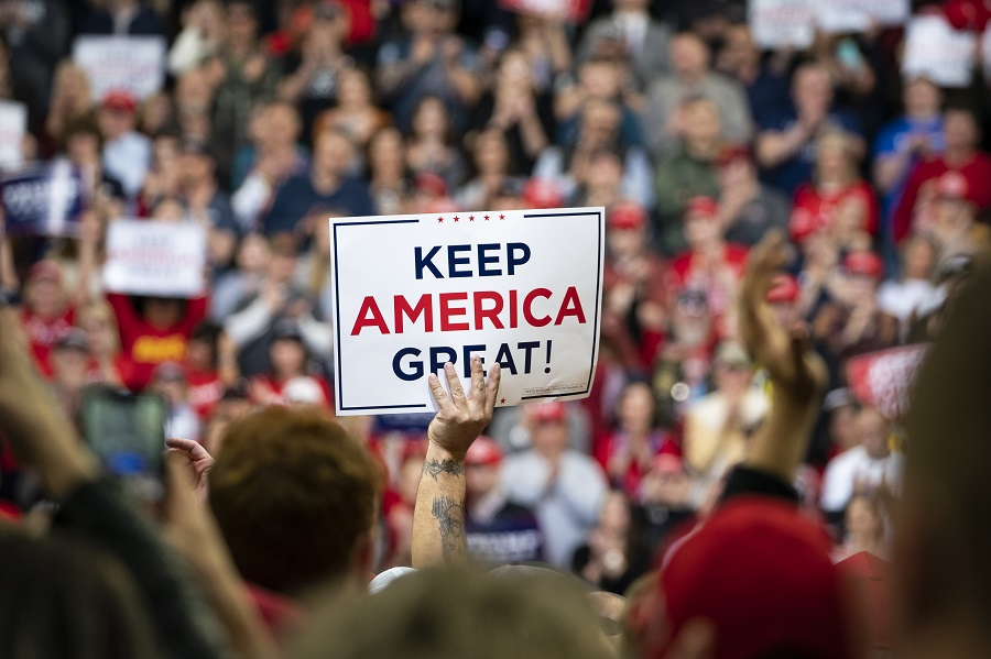 An attendee holds a sign that reads 'Keep America Great!' during a rally for US President Donald Trump in Des Moines, Iowa, on 30 January 2020. (Al Drago/Bloomberg)