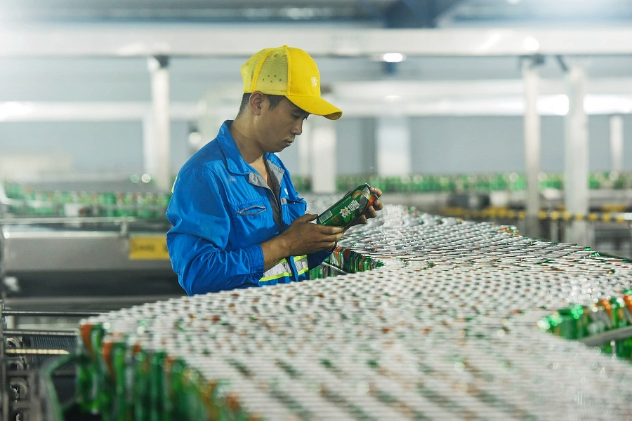 A beer factory in Hangzhou. China's economy expanded at its slowest rate in nearly three decades in the third quarter, hit by cooling domestic demandanda protractedUStradewar. (STR/AFP)