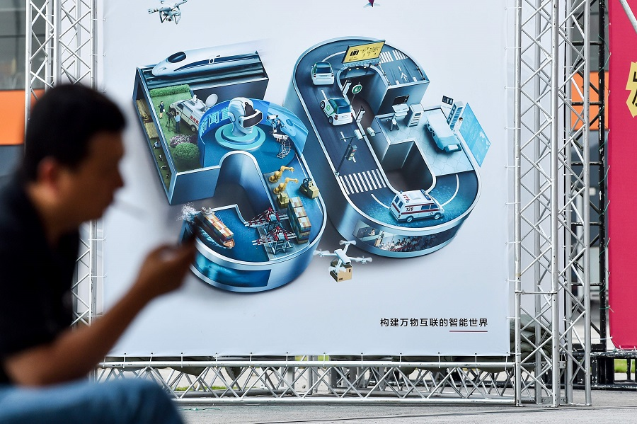 Man in front of 5G display
