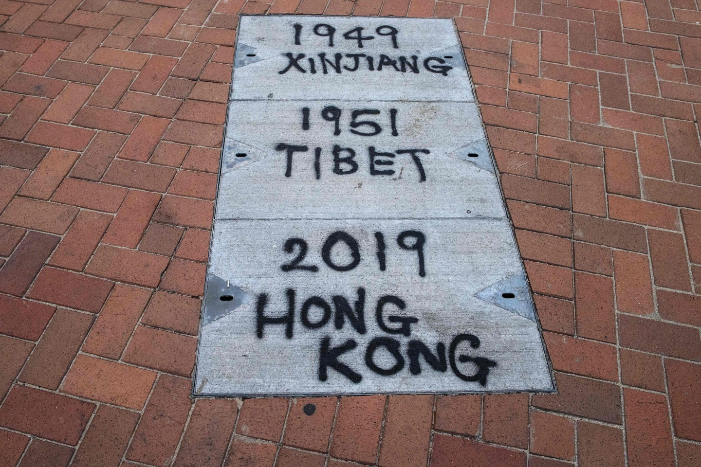 Graffiti relating to Xinjiang and Tibet is seen on the pavement during a rally in Hong Kong on December 22, 2019 to show support for the Uighur minority in China. (Anthony Wallace/AFP)