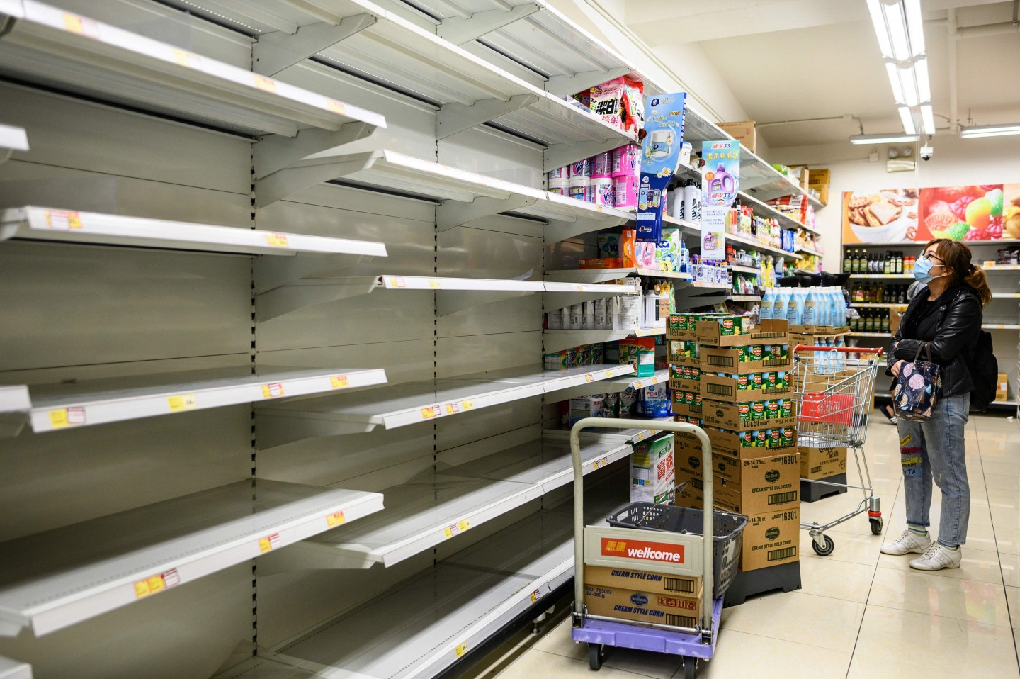 A photo taken on 5 February 2020 shows empty supermarket shelves used for stacking paper towels in Hong Kong. (Philip Fong/AFP)