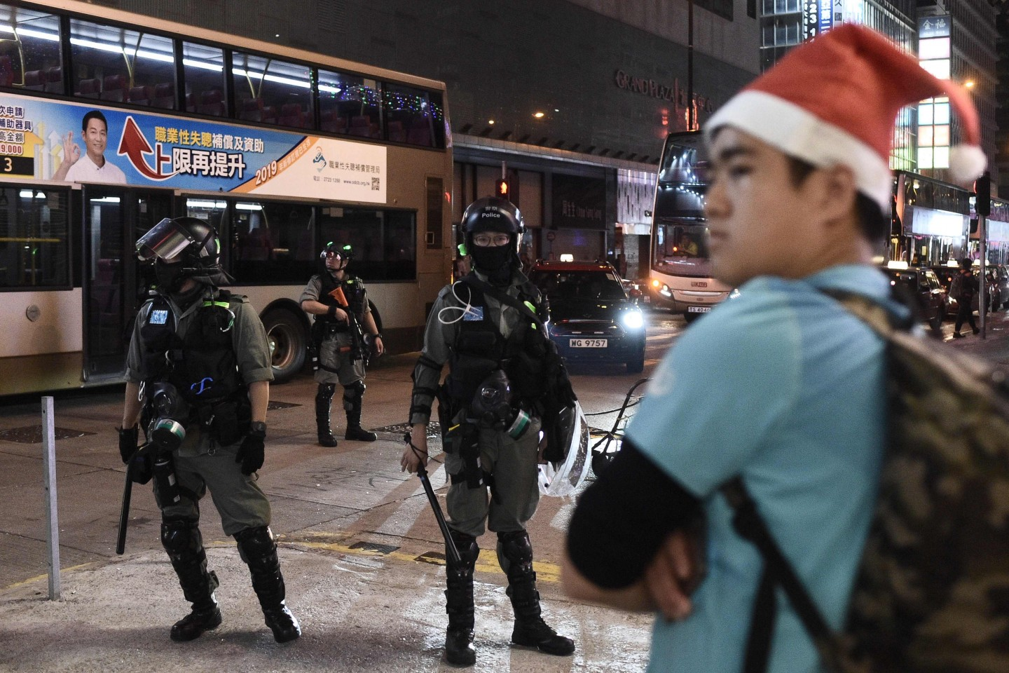 """Hong Kong's Christmas celebrations were marred by sporadic clashes between police and pro-democracy activists on 25 December 2019 as the city's pro-Beijing leader said the festive season was being """"ruined"""" by demonstrators. (Philip Fong/AFP)"""