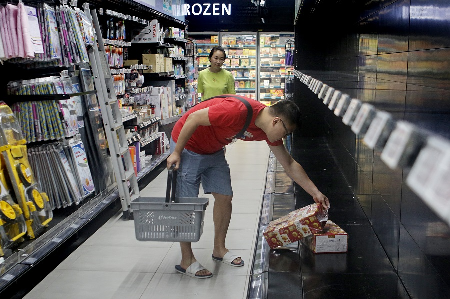 A man buys the last remaining box of tissue paper at a NTUC Fairprice Finest outlet on 8 February 2020. (SPH)