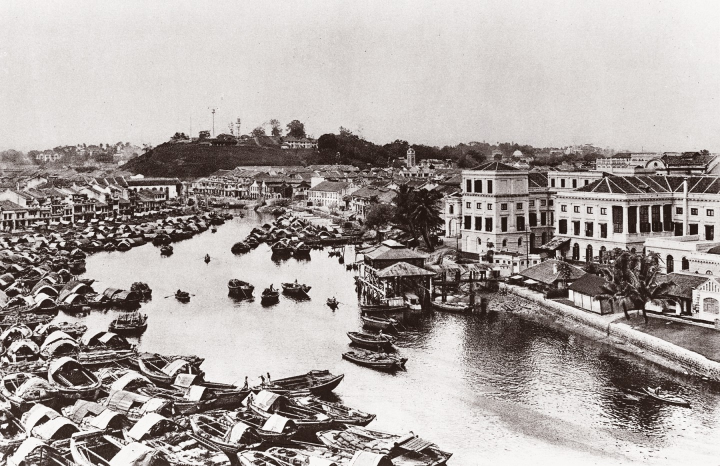 An old picture of Singapore River. At near right is former headquarters of Boustead Singapore, founded in 1828 by Edward Boustead. Boustead Singapore is the second oldest company in Singapore. (Boustead Singapore)
