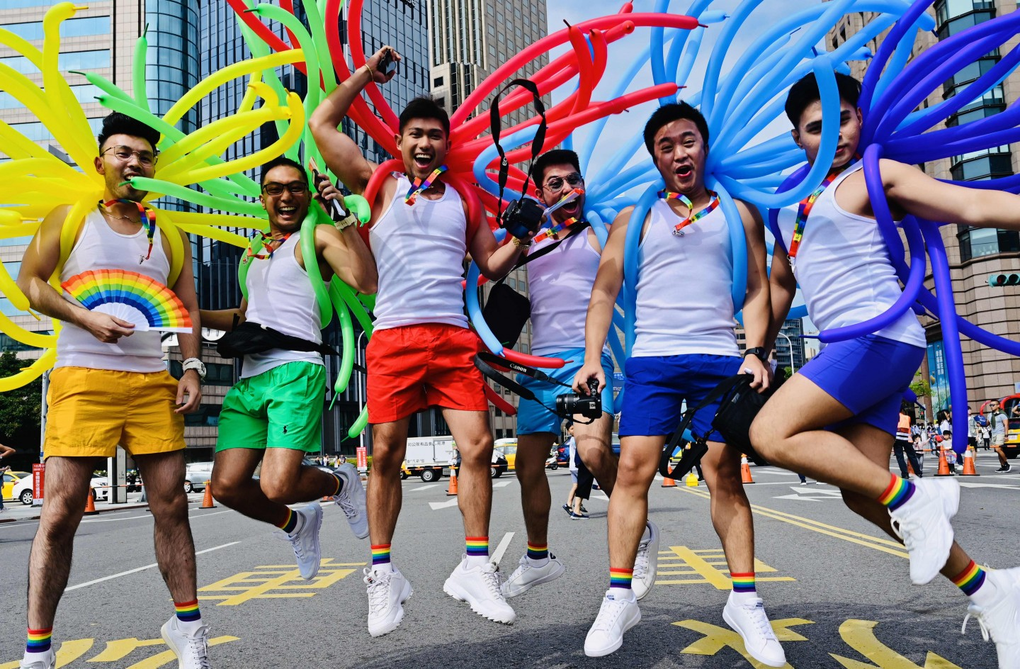 Participants jump in a pose while taking part in the annual gay pride parade in Taipei on October 26, 2019. - Thousands including members of the LGBT community on October 26 took part in the first gay pride parade held after Taiwan earlier this year legalised same-sex marriages, the culmination of a three-decade fight for equality. (Sam Yeh/AFP)