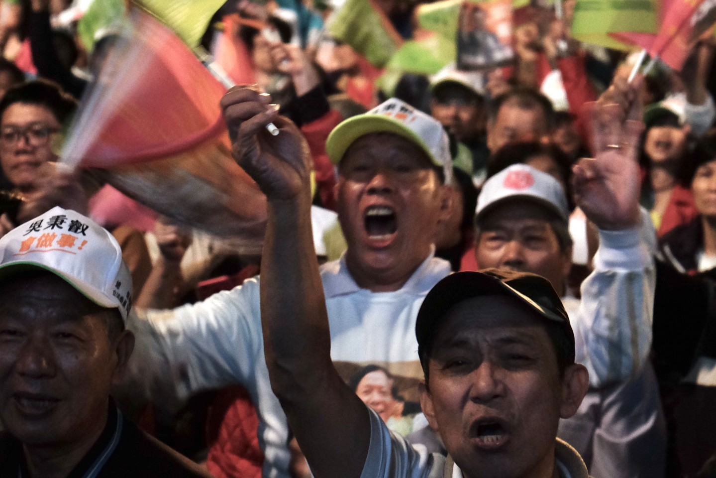 Supporters of Tsai Ing-wen wave flags during a rally at the Xinzhuang Stadium in New Taipei City on January 5, 2020. (Sam Yeh/AFP)