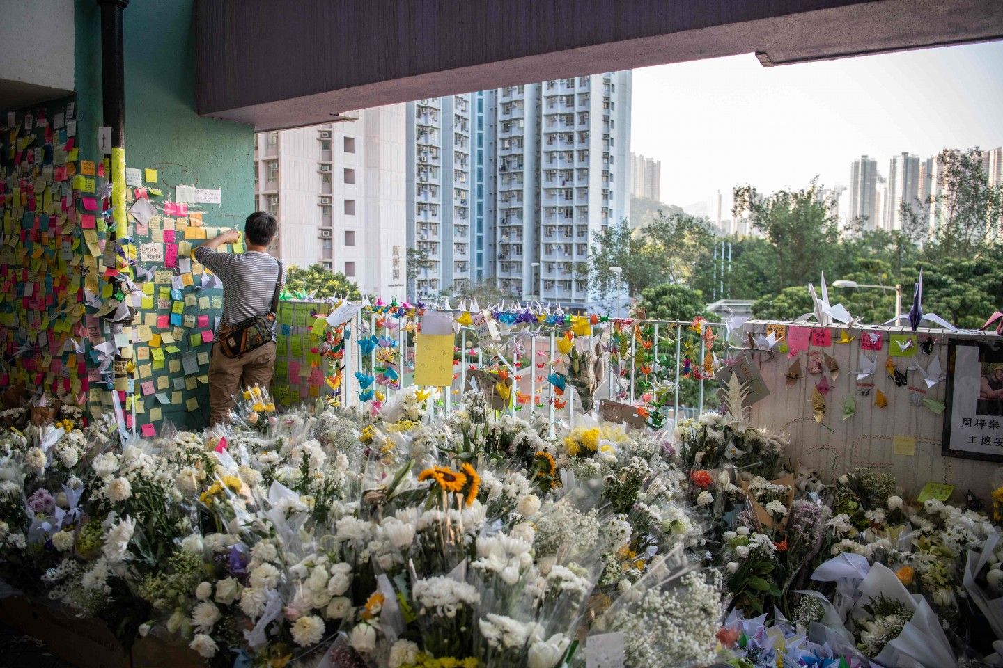 A makeshift memorial overflowing with flowers is seen at the car park where student Alex Chow, 22, fell during a recent protest in the Tseung Kwan O area on the Kowloon side of Hong Kong on November 9, 2019. (Laurel Chor/AFP)