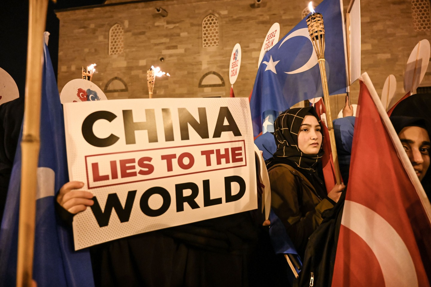 Supporters of China's Muslim Uighur minority wave flag of East Turkestan and hold placards on December 20, 2019 during a demostration at Fatih in Istanbul. They called for an end to the crackdown in China's northwestern region, where upwards of one million Uighurs and other mostly Muslim minorities are believed to be held in re-education camps. (Ozan Kose/AFP)
