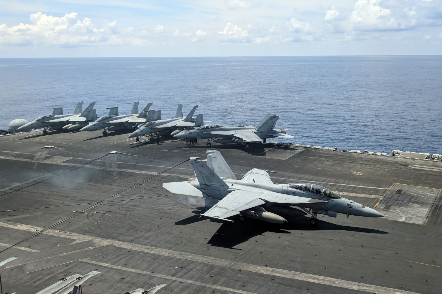 This photograph taken on October 16, 2019 shows a US Navy F/A-18 Super Hornets multirole fighter landing on the flight deck of USS Ronald Reagan (CVN-76) aircraft carrier as it sails in South China Sea. (Catherine Lai/AFP)
