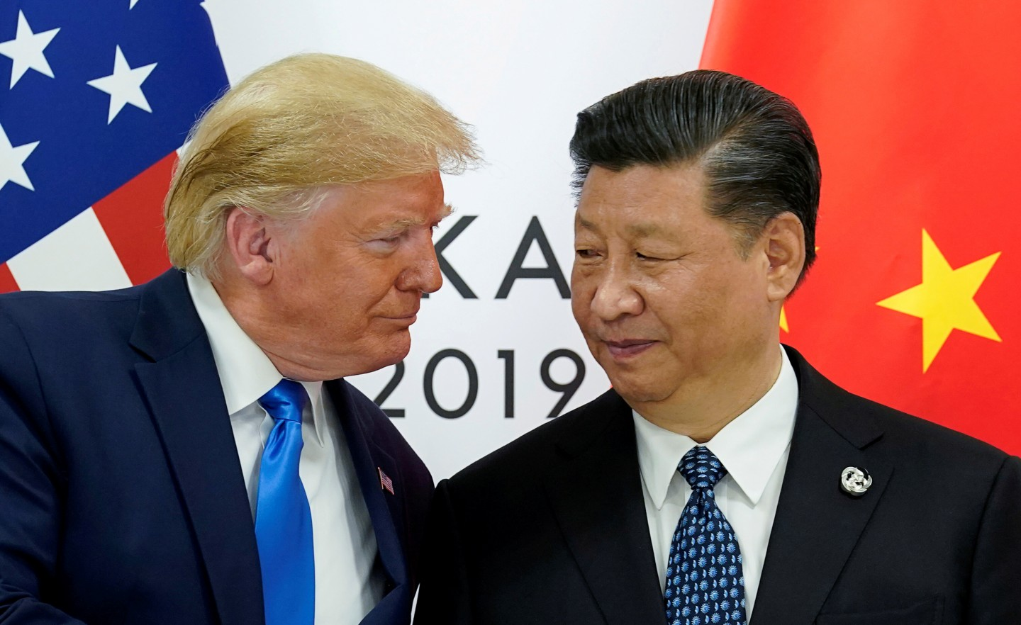 US President Donald Trump meets with China's President Xi Jinping at the start of their bilateral meeting at the G20 leaders summit in Osaka, Japan on 29 June 2019. (Kevin Lamarque/Reuters)
