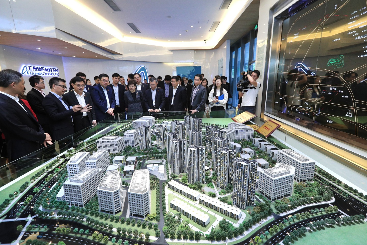 DPM Heng Swee Keat toured the Sino-Singapore Guangzhou Knowledge City, a township being jointly developed by Singapore and China just north of Guangzhou. Here, he is being given a briefing of the Ascendas OneHub Business Park in the township on Monday (May 27, 2019). (MCI)