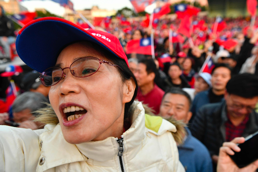 This picture taken on December 8, 2019 shows a supporter of KMT's presidential candidate Han Kuo-yu chanting slogans during a campaign rally at a public stadium in Panchiao district in New Taipei City. (Sam Yeh/AFP)