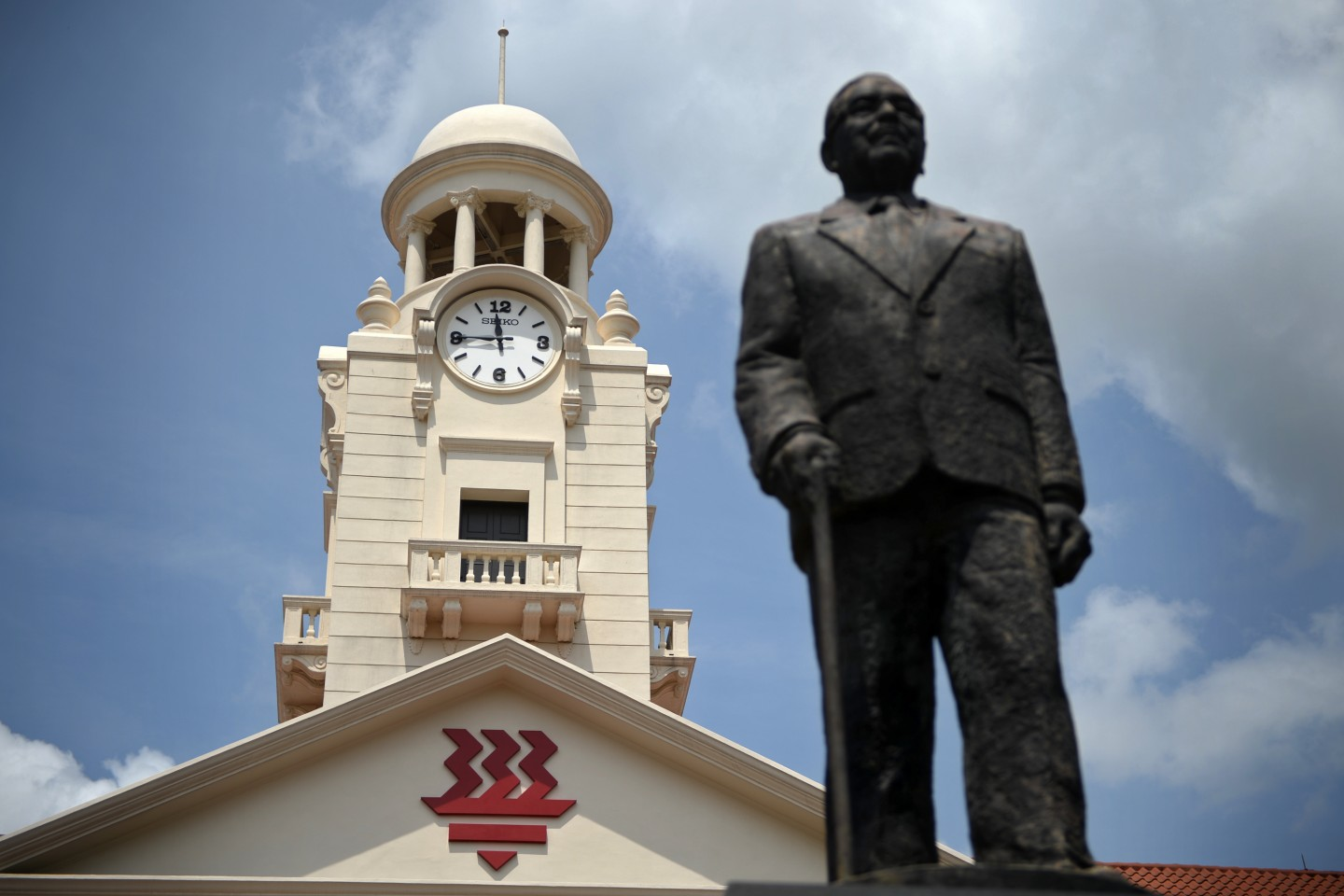 A statue of the school's founder, Tan Kah Kee, stands in front of the Hwa Chong clock tower. Hwa Chong clock tower was built in 1925 with generous donations from prominent Chinese leaders. (SPH)