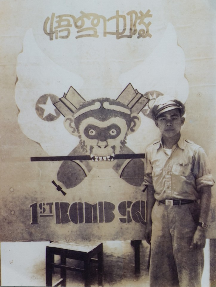 In our standby duties attire, standing in front of our CACW 1st Bomb Squadron insignia, the Monkey God emblem, Hanchung, 1945