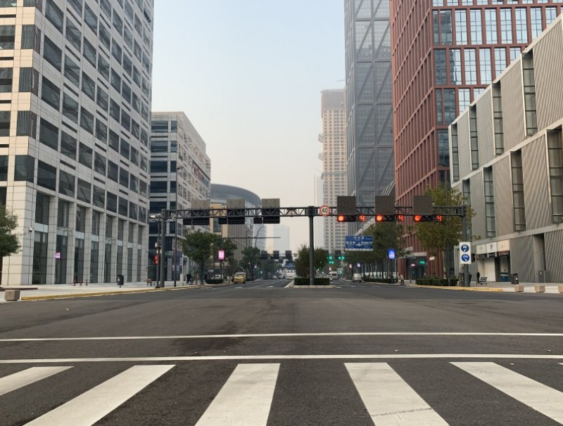 A main street in the business district of Yujiapu is all but deserted on a weekday afternoon.