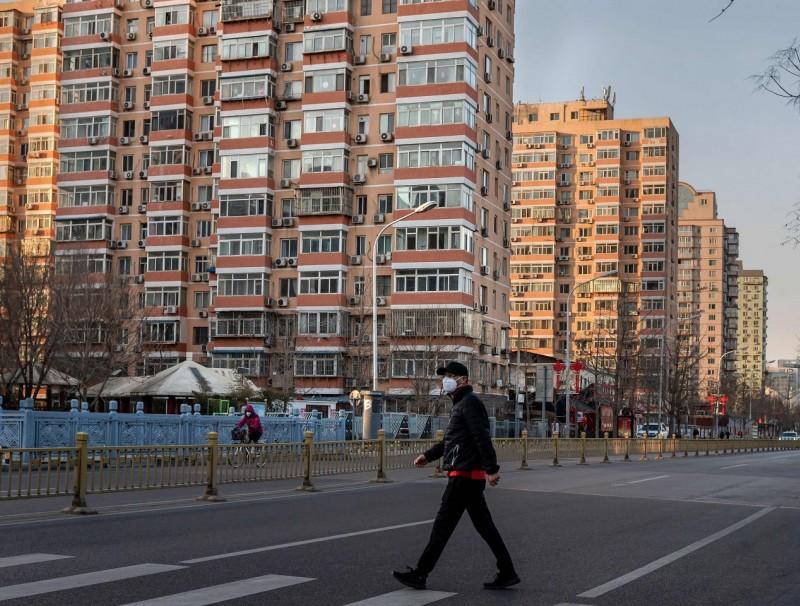 A man wearing a protective mask walks along an empty street in Beijing on 31 January 2020, following the Wuhan coronavirus outbreak. (Nicolas Asfouri/AFP)