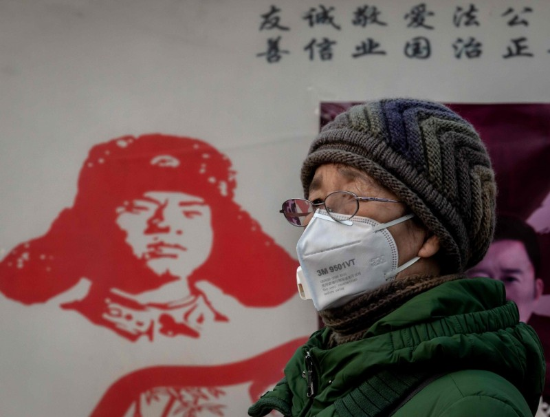 With the Asian giant being the world's second largest economy, no one today will call it a weak country. Yet, the yellow peril ideology does not seem to have disappeared. In this photo taken on 27 January 2020, a woman wearing a protective mask looks on at the Beijing railway station in Beijing. (Nicolas Asfouri/AFP)