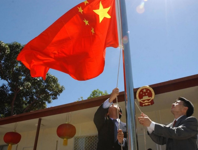The Chinese flag is raised in front of the Chinese Embassy in Dili, capital of Timor-Leste, May 20, 2002. China was the first country in the world to establish diplomatic relations with Timor-Leste. (Xinhua)
