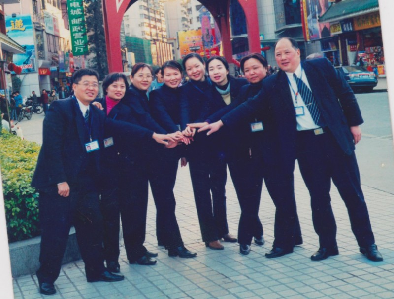 Huang Juan (third from the right) in a group photo with her colleagues from the China Construction Bank. (Photo: Huang Juan)