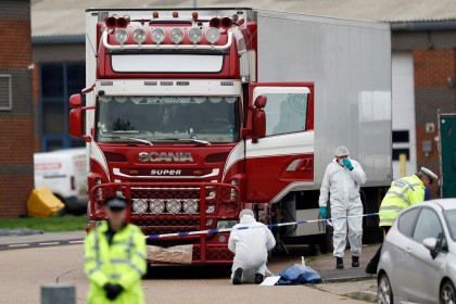 Police are seen at the scene where bodies were discovered in a lorry container, in Grays, Essex, Britain on October 23, 2019. (REUTERS/Peter Nicholls)