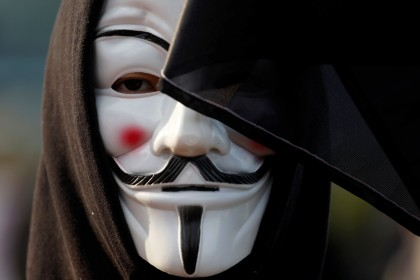 An anti-government demonstrator wearing a Guy Fawkes mask takes part in a protest at Edinburgh Place in Hong Kong on 12 January 2020. (Navesh Chitrakar/Reuters)