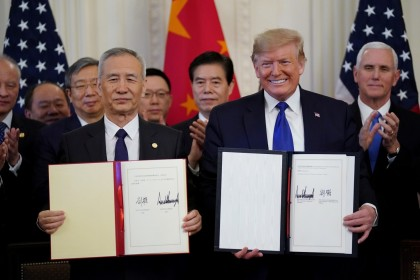 US President Donald Trump and Chinese Vice Premier Liu He signs phase one of the US-China trade agreement in the East Room of the White House in Washington on 15 January 2020. (Kevin Lamarque/Reuters)