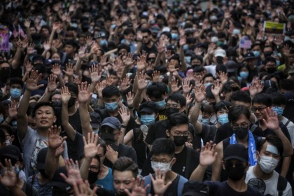 Protesters in Hong Kong hold up their hands to symbolise their five demands. (AFP)