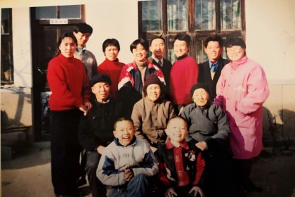 A family portrait with the writer (front row, left).